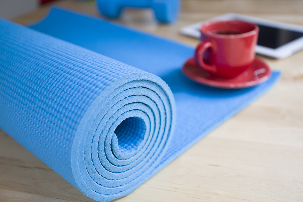 yoga mat and a cup of coffee